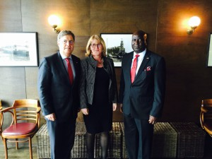 AMBASSADOR STEVENS POSING WITH THE NEW CONSUL AND HIS WIFE